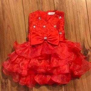 Fancy red ruffled dress.